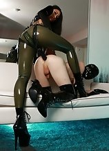 Natalie Mars gets pretty crazy with Mistress Tangent in this one! Watch her get her tight little ass fucked by a huge black strapon in tall leather bo