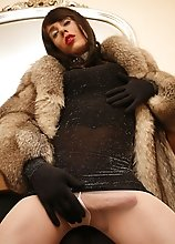 Zoe wearing a thick fur coat in this sexy shoot