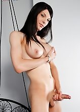 Natalee Skye loves showing off her hot body and her big boobs! Watch her stroking her cock and having fun!