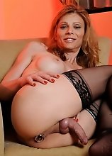 Horny transsexual MILF toying her wet asshole